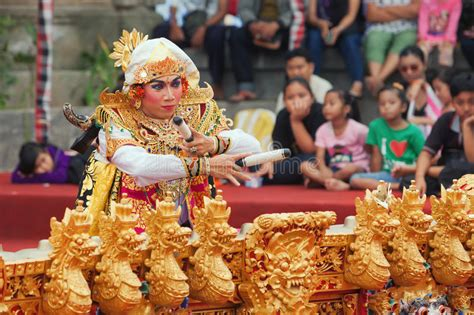 Balinese Man Dancing And Playing Music On Gamelan Gong