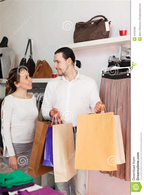 Couples Clothing Store With Shopping Bags At Shop Stock Photo Image