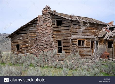old ranch house a 100 year old ranch house with a stone fireplace and hand hewn pine stock photo royalty free