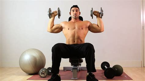 overhead bench press how to do seated overhead dumbbell press arm workout