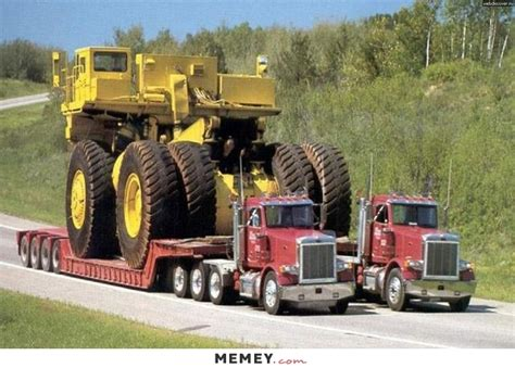 two trucks carrying a giant truck memey com