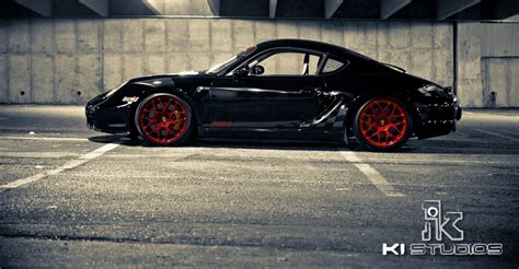 red porsche black wheels black with red wheels