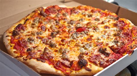 the eat beat the meat deatbeat domino s pizza on queen east junk food s last stand the pizza lobby is not backing