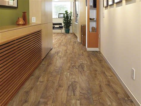 resilient chatham plank 0144v rainforest teak flooring by shaw shaw flooring pinterest