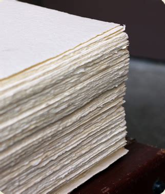 Paper Deckle - deckled edge papers in a stack at www oblationpapers