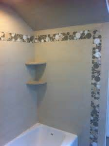 shower using porcelain tile and glass accents