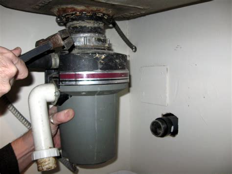 garbage disposal sink flange removal just a with a hammer the garbage disposal