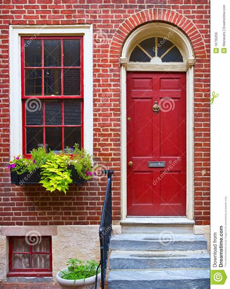brick house with red door colorful red door and brick wall stock photo image 16735256
