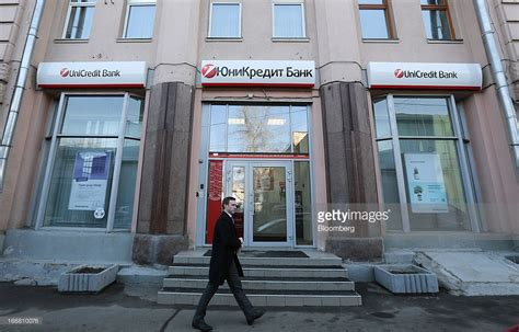 unicredit bank spa a pedestrian passes a unicredit spa bank branch in moscow