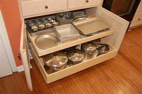 kitchen cabinets with drawers that roll out pull out shelves and a center stile removal traditional