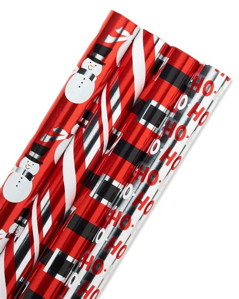 hallmark christmas reversible wrapping paper candy canes 3 pack foil reversible wrapping paper black and silver stripe snowmen ho