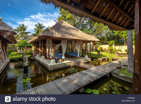 buy a house in bali spa area of a star hotel in bali massage area spa thatched houses stock photo