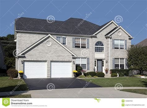 light brick house light brick home with double arched garage stock images image 13320704