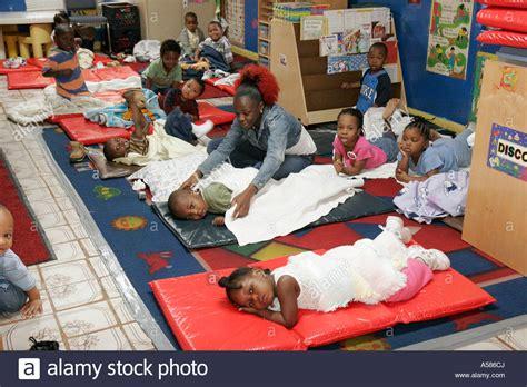 day care miami miami florida haiti kiddie academy inner city day care nap stock photo royalty