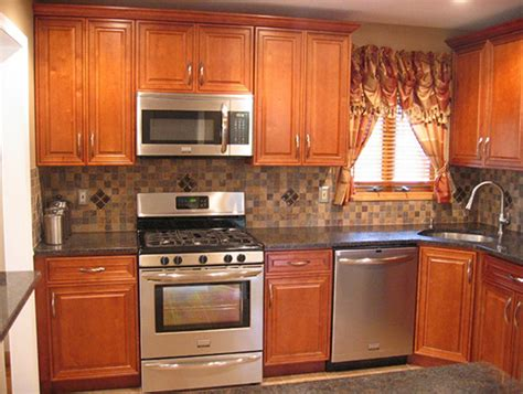 kitchen backsplash with oak cabinets and black appliances beautiful oak cabinets with granite countertops and