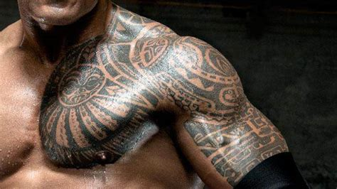 the rock s chest tattoo the coolest tattoos in wwe history wwe bulletin