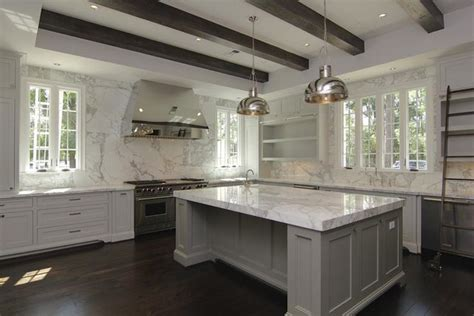 white gray glaze kitchen island with gray marble counter mix of white gray cabinets large island marble