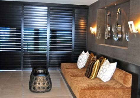 enhancing your interiors with modern wood shutters 10 amazing shutters to enhance every window