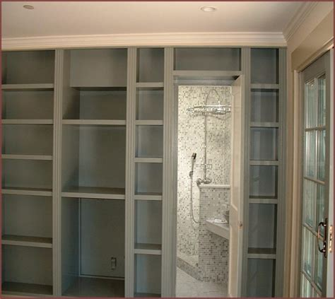 built in bookcase with doors built in bookcases around a fireplace home design ideas