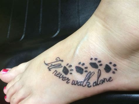 alone tattoo i will never walk alone pawprint foot