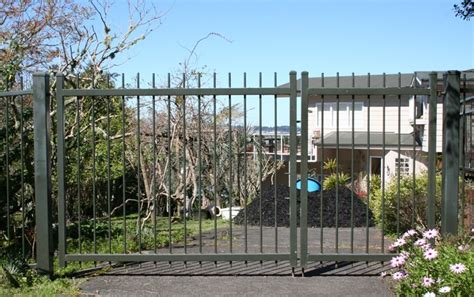 when gates swing open timber fencing auckland pool fencing auckland security