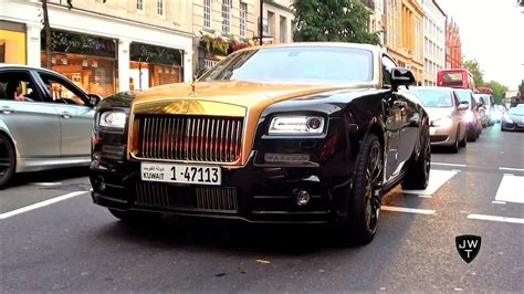 rolls royce gold and white black gold mansory rolls royce wraith driving around