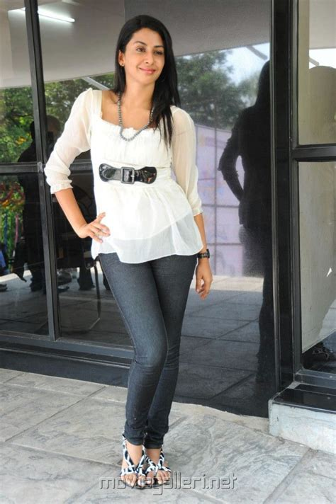bollywood heroine in jeans actress gayatri iyer white top and black jeans photoshoot