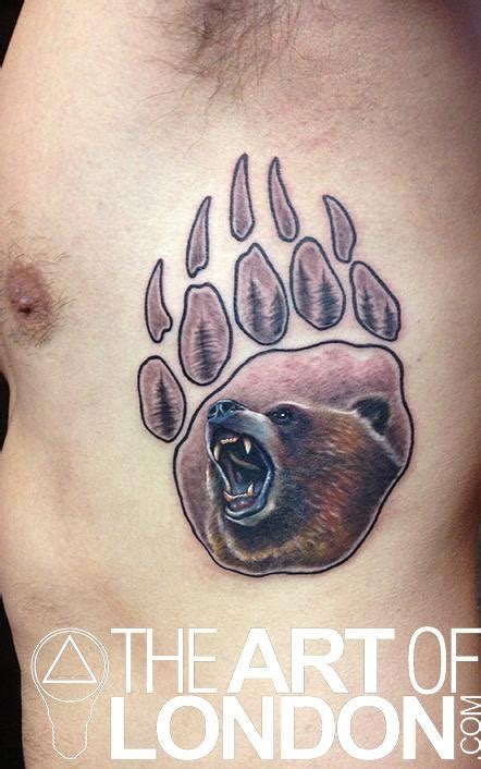 grizzly bear paw print tattoo by london reese tattoonow