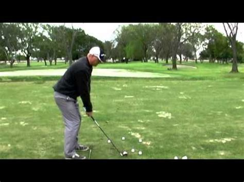 how to swing down on the golf ball golf swing hitting solid iron shots and compressing the