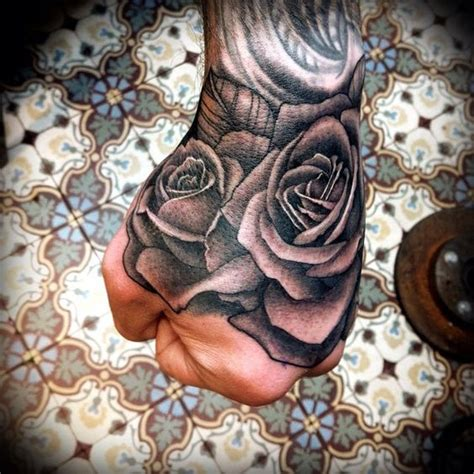 rose tattoo hand meaning by tim hendricks tattoos tim o brien
