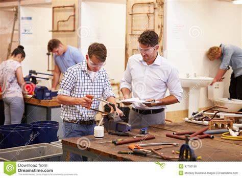 Colleges For Plumbing by Helping College Students Studying Plumbing Stock