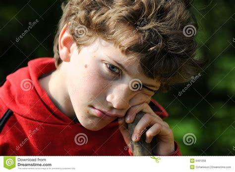 boy sulking boy sulking royalty free stock photos image 9461258