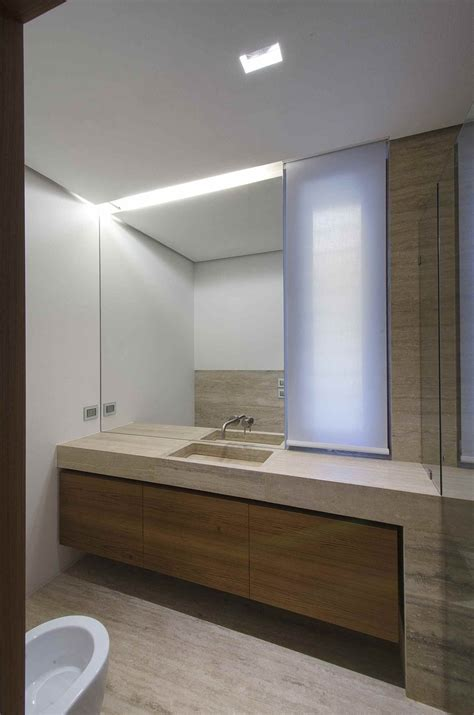 bathroom minimal home with travertine exteriors and interiors