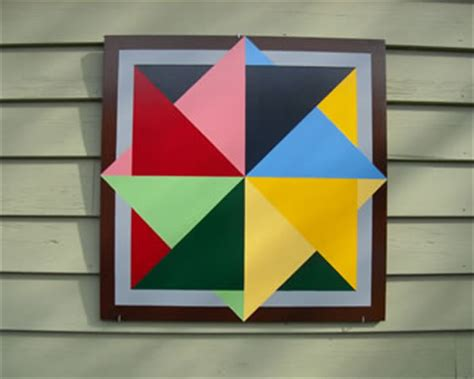 What Are The Quilt Patterns On Barns by Spinning Color Wheel