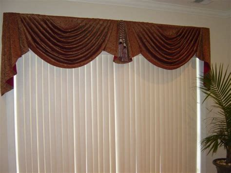 swag curtains for large windows 12 best images about living room windows on