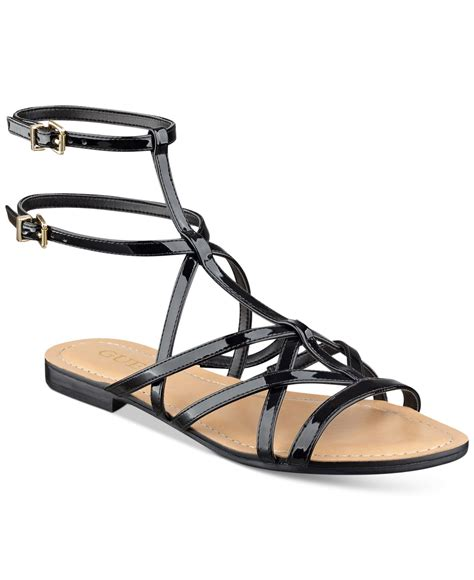 black flat strappy shoes guess s mannie strappy flat sandals in black lyst
