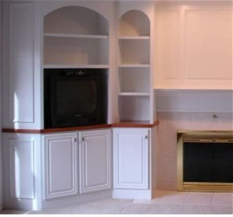 crafted built in with arches and corner cabinet by