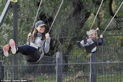 is swinging good carrie bickmore enjoys quality time at the park with