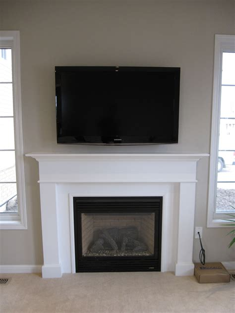 height to place tv on wall how to get the proper fireplace mantel height for the sake