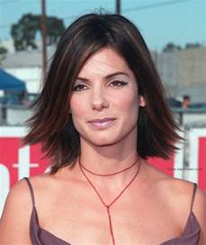 medium flipped hair sandra bullock youthful medium length hairstyle with highlights and a flip at the ends