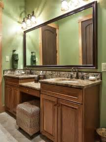 traditional green bathroom with light wood vanity hgtv