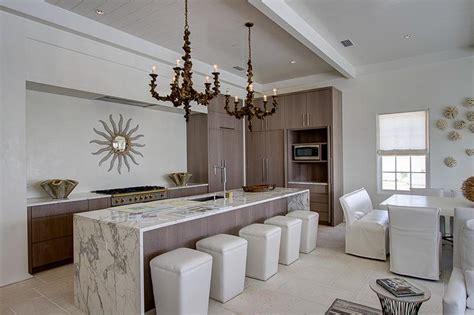 long kitchen island  white  gray marble waterfall countertop cottage kitchen