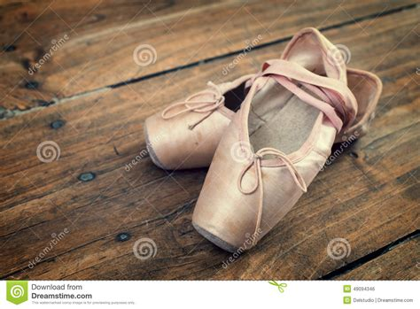 old shoes on the floor vintage beauty fashion photos old pink ballet shoes on a wooden floor stock photo