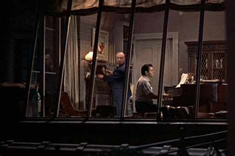 the window at the rear of the apartment the shadow stories books alfred hitchcock s cameo in quot rear window quot 1954 he sets