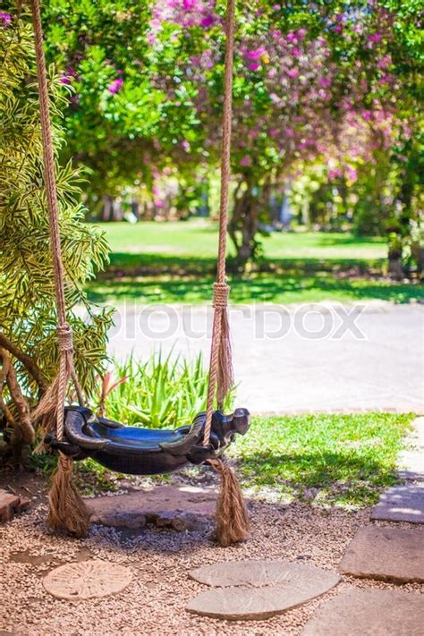 Close Up Of A Beautiful Swing In The Garden Stock Photo
