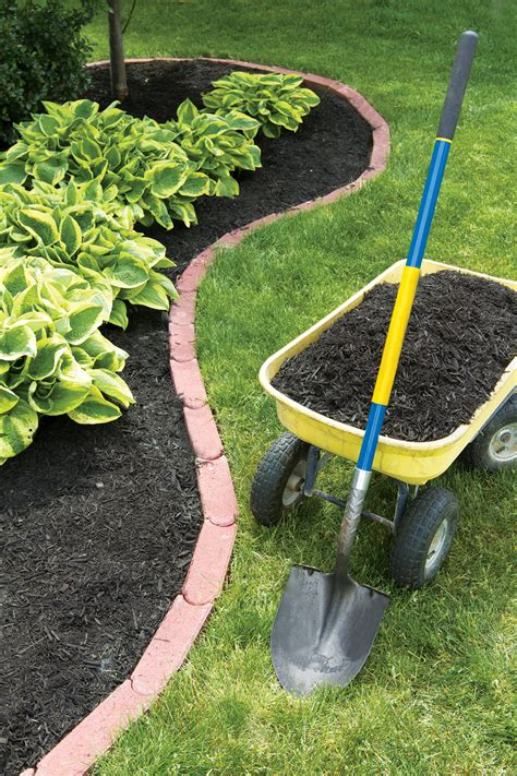 how to mulch a flower bed spring garden cleanup yields happy healthy plants state