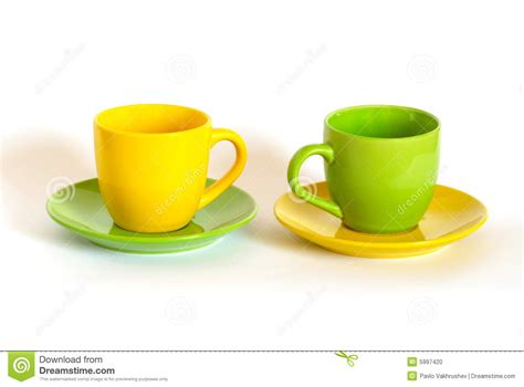 two colored two colored tea cups and saucers stock photo image 5997420