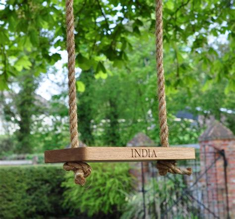 swing in the garden small oak and rope garden swing by the oak rope company
