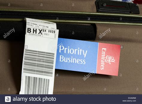 emirates luggage emirates priority business class luggage tag on a suitcase