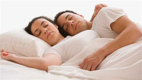 wallpaper couple in bed what your couple sleeping style says about your relationship
